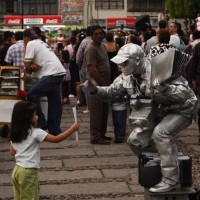 Street performer takes a picture of little girl
