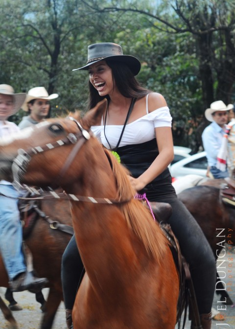 Paisa Girl riding a horse in Medellin