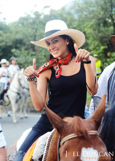 Beautiful Paisa girl riding a horse in Medellin